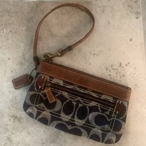 COACH LEATHER AND JEAN WRISTLET